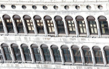 Windows in the historic palace in saint Mark Square in Venice
