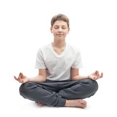 Young boy meditating