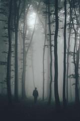 spooky man silhouette in dark forest