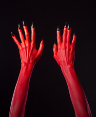 Red devil hands with black nails
