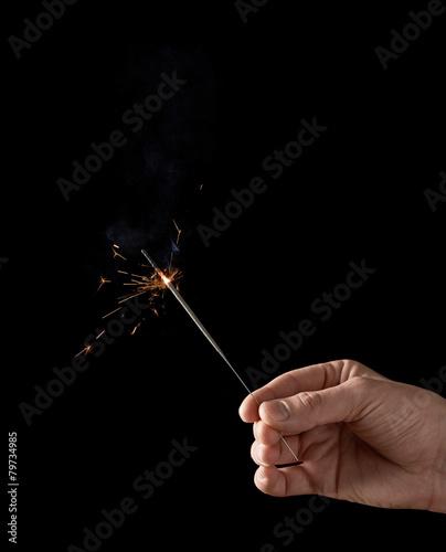 In de dag Vuur / Vlam Holding a burning sparkler