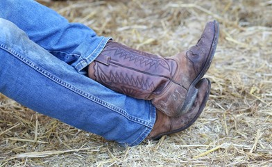 rest of the lazy cowboy in the barn of the farm