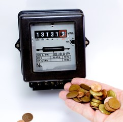 electricity meter with the hand full of European currencies