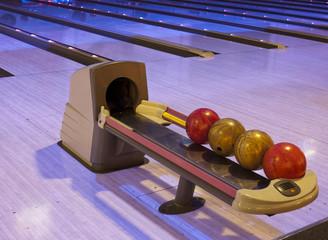 Close up of bowling balls, bowling pins