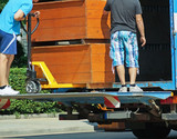 Men are moving large furnitures into a truck