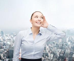 smiling businesswoman listening gossig