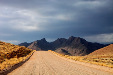 dusty road in the mountainous landscape of central Namibia