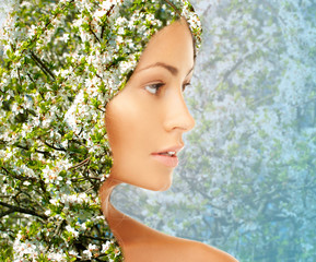 young woman face over blooming tree pattern