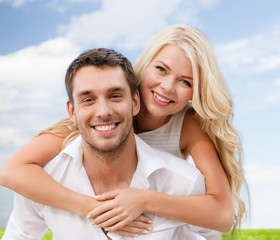 couple having fun over sky and grass background