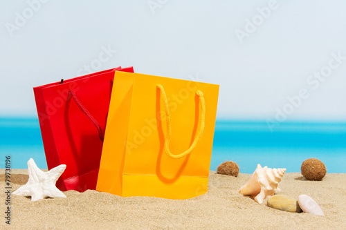 Summer signings, bags on the beach - 79738196