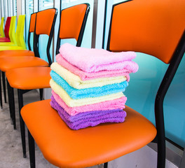 Stack of towels on chairs