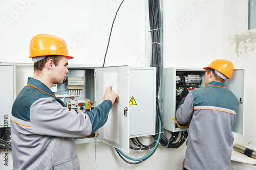 two electrician workers - 79738761