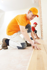 parquet workers at flooring work