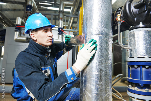 industrial worker at insulation work - 79738983