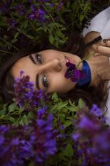 portrait of a girl lying on a flower meadow