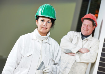 Female and male plasterers portrait