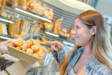 Woman pointing at bakery display