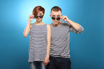 Couple in striped clothing, stripped vest, in sunglasses