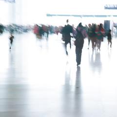 passengers rushing at big city station