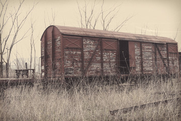 Old and abandoned cargo train with wooden cars