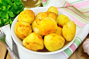 Potatoes fried in plate on fabric