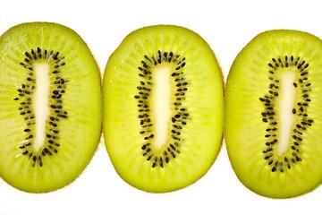 Fresh kiwi fruit cut in round slices, isolated background