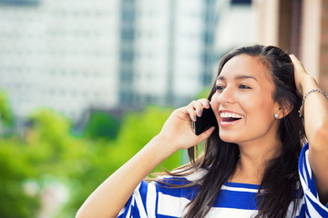 laughing woman talking on mobile phone