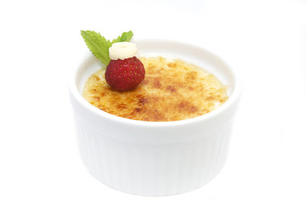portion of the cream brulee on a white background