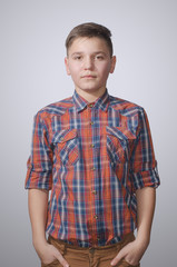 Teenager on gray-white background