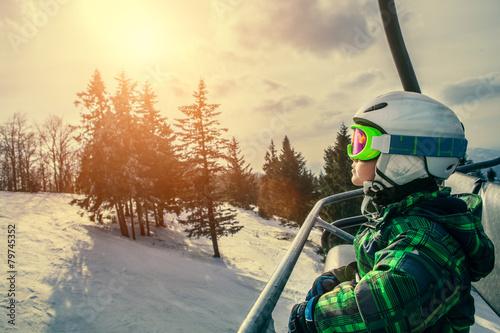 Little skier on the ski lift - 79745352