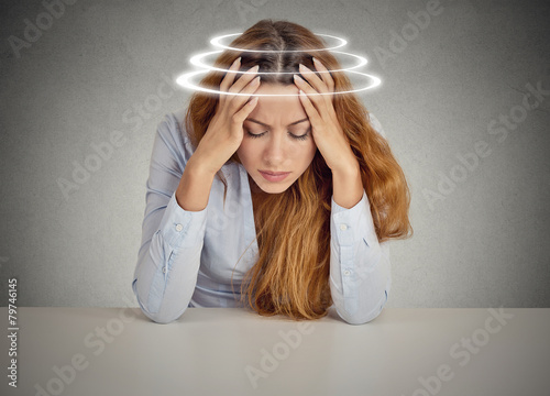 Woman with vertigo. Young patient suffering from dizziness - 79746145