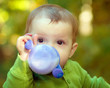 Baby drinking milk out of a sippy cup - 79747742