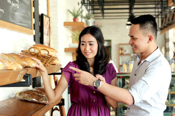 young couple make a choice to bread they will buy
