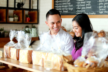 young couple at bakery shop