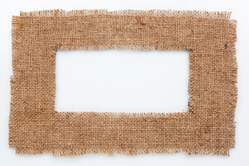Frame of burlap, lies on a white background