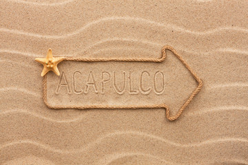 Arrow made of rope and sea shells with the word Acapulco on the
