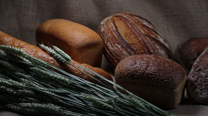 Bread on sackcloth with wheat spikelets