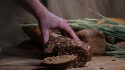 Cutting of rye bread on a wooden board