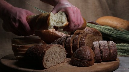 Breaking French bread on the bread table