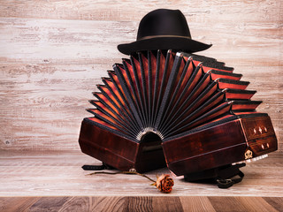 Bandoneon, tango instrument, and a hut