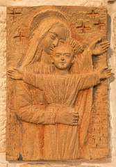 Bethlehem - Madonna with the child. The relief in terracotta .