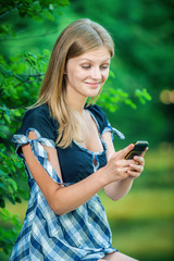 Beautiful young woman with mobile phone