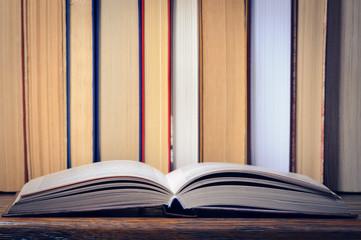 Open book on a shelf