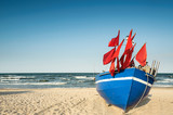 Traditional German fisherman boat on a sandy shore