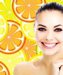 Happy female on a background with citrus slices