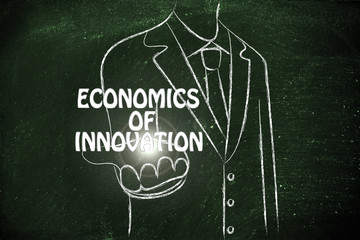 business man handing out the word Economics of Innovation