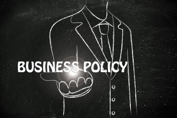 business man handing out the word Business Policy