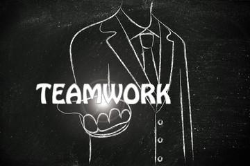 business man handing out the word Teamwork