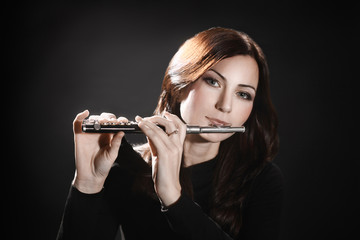 Flute piccolo flutist playing flute music instrument