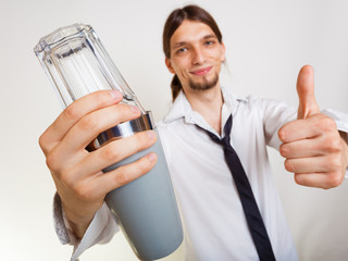 Happy man with shaker making cocktail drink